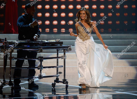 Miss USA 2013 From left, DJ Paul 'Pauly D' DelVecchio performs as Miss Connecticut Erin Brady walks on stage during the Miss USA 2013 pageant, in Las Vegas