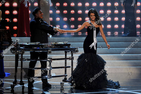 Miss USA 2013 From left, DJ Paul 'Pauly D' DelVecchio performs as Miss Alabama Mary Margaret McCord walks on stage during the Miss USA 2013 pageant, in Las Vegas