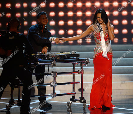 Miss USA 2013 From left, DJ Paul 'Pauly D' DelVecchio performs as Miss Texas Ali Nichole Nugent walks on stage during the Miss USA 2013 pageant, in Las Vegas