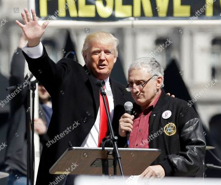Donald Trump Donald Trump, left, and Carl Paladino, who ran for governor of New York as a Republican in 2010, speak during a gun rights rally at the Empire State Plaza, in Albany, N.Y. Activists are seeking a repeal of a 2013 state law that outlawed the sales of some popular guns like the AR-15. The law championed by Gov. Andrew Cuomo has been criticized as unconstitutional by some gun rights activists
