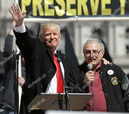 Donald Trump, Carl Paladino Donald Trump, left, and Carl Paladino, who ran for governor of New York as a Republican in 2010, speak during a gun rights rally at the Empire State Plaza, in Albany, N.Y. Activists are seeking a repeal of a 2013 state law that outlawed the sales of some popular guns like the AR-15. The law championed by Gov. Andrew Cuomo has been criticized as unconstitutional by some gun rights activists