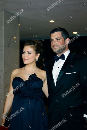 Alyssa Milano, David Bugliari Alyssa Milano, left, and David Bugliari arrive for the White House Correspondents Dinner in Washington