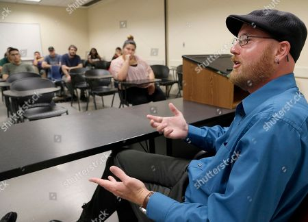 Stock Picture of Ryan Reyes, whose partner Daniel Kaufman was killed in the San Bernardino, Calif., terrorist attacks, speaks to students at California State University in San Bernardino, . Reyes encouraged tolerance in the wake of the shooting six months ago and said his anger has shifted from the attack to how the nation has responded