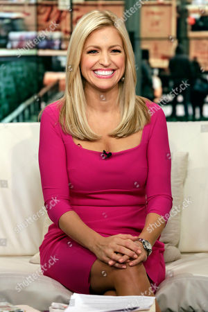 "Stock Image of Ainsley Earhardt Fox News host Ainsley Earhardt makes her debut as co-host of the network's morning show ""Fox & Friends"" television program, in New York, . Earhardt replaces Elisabeth Hasselbeck on the""curvy couch"" with Steve Doocy and Brian Kilmeade"