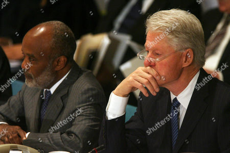 """Rene Garcia Preval, Bill Clinton Former U.S. President Bill Clinton, right, listens as Haitian President Rene Garcia Preval, left, delivers an address to the opening session of the International Donors' Conference towards a """"New Future for Haiti,"""", at United Nations headquarters"""
