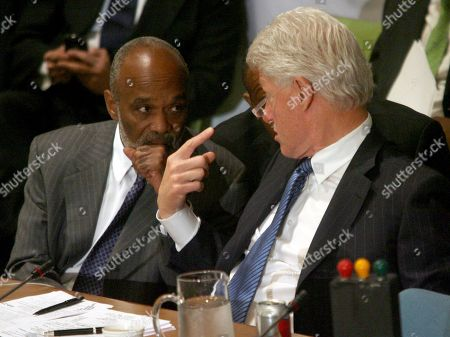 """Rene Garcia Preval, Bill Clinton Haitian President Rene Garcia Preval, left, speaks to former U.S. President Bill Clinton during the opening session of the International Donors' Conference towards a """"New Future for Haiti,"""", at United Nations headquarters"""