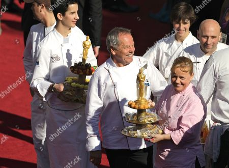 Chef Wolfgang Puck, third from left, and executive pastry chef, Sherry Yard, right, arrive before the 83rd Academy Awards, in the Hollywood section of Los Angeles