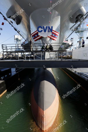 Newport News Shipbuilding workers prepare the for the christening of the Navy's newest nuclear powered aircraft carrier USS Gerald R. Ford at the shipyard in Newport News, Va., . Former President ford's daughter Susan Ford Bales will christen the ship Saturday