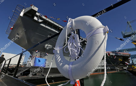 A life ring is displayed on a barge at Newport News Shipbuilding as workers prepare the for the christening of the Navy's newest nuclear powered aircraft carrier USS Gerald R. Ford at the shipyard in Newport News, Va., . Former President ford's daughter Susan Ford Bales will christen the ship Saturday