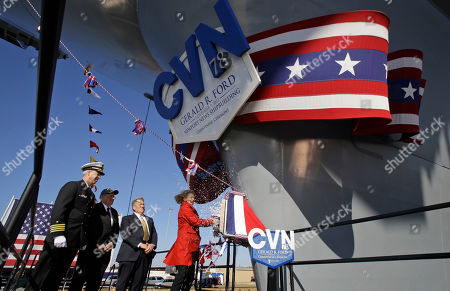 Stock Photo of Susan Ford Bales, John F. Meier, Carl Levin, Matt Mulherin Susan Ford Bales, daughter of former President Gerald R. Ford christens the Navy's newest nuclear powered aircraft carrier USS Gerald R. Ford at Newport News Shipbuilding in Newport News, Va., . The Ford class represents the first new aircraft carrier design in more than 40 years. Among other things, it will be able to launch jets faster than previous aircraft carriers and will require fewer crew members. Standing behind Bales is Commanding officer of the ship, John F. Meier, left, Sen. Carl Levin, D-Mich., second from left, and president of Newport News Shipbuilding, Matt Mulherin