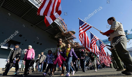 Stock Photo of An honor guard of boy scouts from the local area and Michigan welcome visitors for the christening of the Navy's newest nuclear powered aircraft carrier USS Gerald R. Ford at the shipyard in Newport News, Va., . Former President Ford's daughter Susan Ford Bales will christen the ship