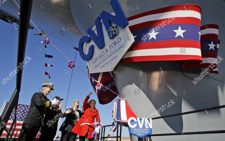 Stock Image of Susan Ford Bales, John F. Meier, Carl Levin, Matt Mulherin Susan Ford Bales, daughter of former President Gerald R. Ford, right, cheers after christening the Navy's newest nuclear powered aircraft carrier USS Gerald R. Ford at Newport News Shipbuilding in Newport News, Va., . The Ford class represents the first new aircraft carrier design in more than 40 years. Among other things, it will be able to launch jets faster than previous aircraft carriers and will require fewer crew members. Standing behind Bales is Commanding officer of the ship, John F. Meier, left, Sen. Carl Levin, D-Mich., second from left, and president of Newport News Shipbuilding, Matt Mulherin