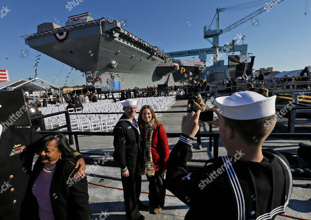 Ben Hansen, Jessica Hansen U.S. Navy Bosons mate, Ben Hansen and his wife Jessica, of Edmore Mich., are photographed in front of the Navy's newest nuclear powered aircraft carrier USS Gerald R. Ford for the christening of the ship at the Newport News Shipbuilding in Newport News, Va., . Former President Ford's daughter Susan Ford Bales will christen the ship