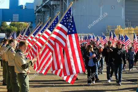 An honor guard of boy scouts from the local area and Michigan welcome visitors for the christening of the Navy's newest nuclear powered aircraft carrier USS Gerald R. Ford at the shipyard in Newport News, Va., . Former President Ford's daughter Susan Ford Bales will christen the ship