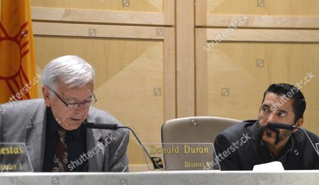 Albuquerque school board president Donald Duran, left, announces, that Superintendent Luis Valentino would resign as board member Steven Michael Quezada, right, looks on in Albuquerque, N.M. Valentino had faced scrutiny after only two months on the job following his hiring of an administrator charged with child sex abuse