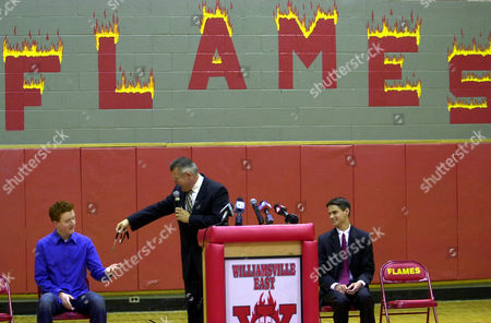 STEVENS MILLER NEWELL American Idol finalist John Stevens accepts the key to the school elevator from Principal Neal Miller as Student Council President Patrick Newell, right, looks on during a school assembly welcoming Stevens back to Williamsville East High School in Williamsville, N.Y