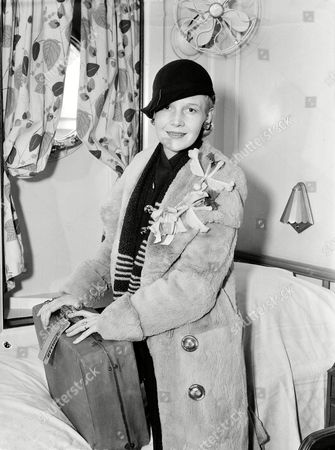 Actress Ann Harding is seen in her stateroom aboard the ocean liner President Coolidge, in San Francisco, Calif., just before sailing off for Hong Kong, on