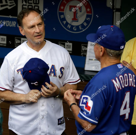 Samuel A. Alito, Jackie Moore United States Supreme Court Associate Justice Samuel A. Alito, Jr. talks with Texas Rangers bench coach Jackie Moore (4) in the dugout before Alito threw out the ceremonial pitch before a baseball game against the Oakland Athletics, in Arlington, Texas