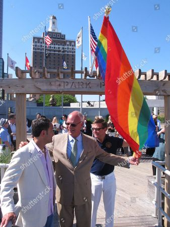Rich Helfant, left, president of the Greater Atlantic City LGBT Alliance, speaks with Atlantic City, N.J. Mayor Don Guardian, center, and former city councilman and longtime gay activist John Schultz, right, on the Atlantic City boardwalk, . Atlantic City is planning a series of events to attract gay tourists, who are becoming an increasingly important part of the resort's growth strategy