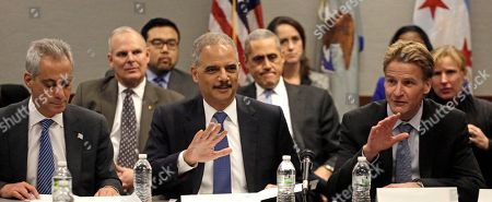 """Eric Holder, Rahm Emanuel, Zachary T. Fardon From Left, Chicago Mayor Rahm Emanuel, U.S. Attorney General Eric Holder and US Attorney for the Northern District of Illinois, Zachary T. Fardon, participate in a 'Building Community Trust' roundtable discussion with police and community leaders, in Chicago. Holder says the nation is facing """"critical times"""" when it comes to the lack of trust that exists between some communities and law enforcement, and that the solution is confronting the issue and both sides need to understand each other. The meeting is part of an effort launched by President Barack Obama after clashes between protesters and police in Ferguson, Missouri"""