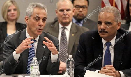 """Eric Holder, Rahm Emanuel From Left, Chicago Mayor Rahm Emanuel, and U.S. Attorney General Eric Holder participate in a 'Building Community Trust' roundtable discussion with police and community leaders, in Chicago. Holder says the nation is facing """"critical times"""" when it comes to the lack of trust that exists between some communities and law enforcement, and that the solution is confronting the issue and both sides need to understand each other. The meeting is part of an effort launched by President Barack Obama after clashes between protesters and police in Ferguson, Missouri"""