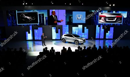 John Mendel, Executive Vice President of Sales, Honda America, introduces the Honda Urban SUV Concept at media previews for the North American International Auto Show in Detroit