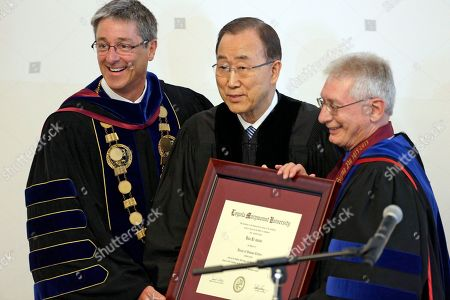 Ban Ki Moon, Timothy Law Snyder, Robert Caro United Nations Secretary-General Ban Ki-moon, center, poses with his honorary Doctor of Humane Letters degree from Loyola Marymount University president Timothy Law Snyder, left, and Robert Caro, LMU Vice President for Mission and Ministry, on the campus in Los Angeles . The university said in a statement that Ban, a former diplomat in South Korea's Ministry of Foreign Affairs, was honored for his humanitarian accomplishments and dedication to the UN. During Ban's tenure, which began in January, 2007, the UN has advanced major initiatives on climate change, violence against women and the Ebola crisis