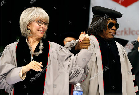 Rita Moreno, Milton Nascimento Rita Moreno, left, clasps hands with Milton Nascimento as he walks to get an honorary doctor of music degree during Berklee College of Music commencement ceremonies in Boston