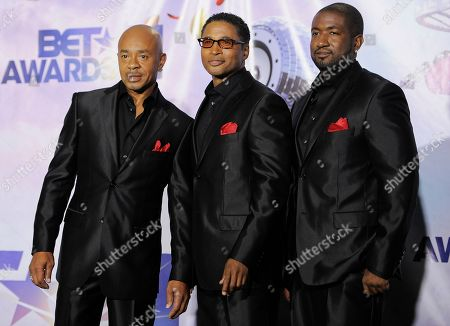 Stock Image of Keith Mitchell, Kevon Edmonds, Melvin Edmonds Keith Mitchell, Kevon Edmonds, and Jason Edmonds of the band After 7 pose backstage at the BET Awards, in Los Angeles