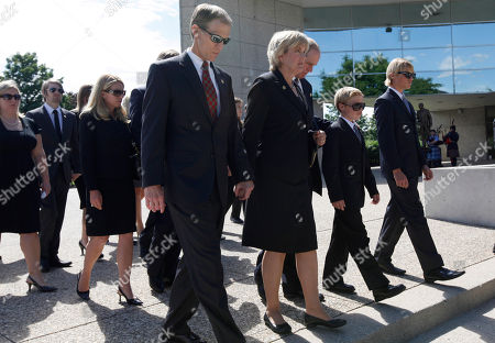Michael Ford, Susan Ford Bales, Steve Ford From left, Michael Ford, Susan Ford Bales, and Steve Ford lead the family to the burial of first lady Betty Ford at the Gerald R. Ford Presidential Museum, in Grand Rapids, Mich
