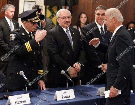 Joe Biden, Richard Evans Vice President Joe Biden returns a salute from SEPTA Chief Richard Evans, left, before a roundtable to discuss the impact of budget cuts on their ability to effectively police their communities, in Philadelphia
