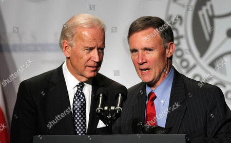 Stock Picture of Joe Biden Vice President Joe Biden speaks with Joe McQuaid of the Manchester Union Leader at the Nackey S. Loeb First Amendment Awards Ceremony, in Concord, N.H