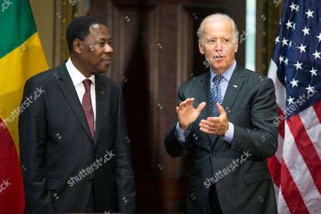 "Joe Biden Vice President Joe Biden, right, stands with Benin's president Thomas Boni Yayi, during a Compact Signing Ceremony in the Indian Treaty Room on the White House complex,, in Washington. The compact is for a $375 million Millennium Challenge Corporation grant to ""reduce poverty through economic growth by making a strategic investment in Benin's electric power sector"