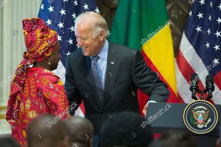 Joe Biden, Angelique Kidjo Vice President Joe Biden, right, greets Grammy award winner Angelique Kidjo during a Compact Signing Ceremony with Benin's president Thomas Boni Yayi, in the Indian Treaty Room on the White House complex,, in Washington