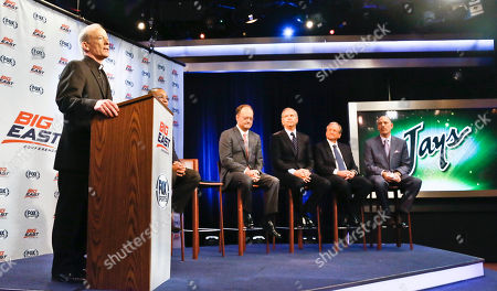 Rev. Brian Shanley, far left, Providence University President, John DeGioia, fourth from right, Georgetown University President, Randy Freer, third from right, FOX Sports President and COO, Larry Jones, second from right, and FOX Sports V.P. and Madison Square Garden Executive Vice President Joel Fisher, far right, hold a press conference on in New York. Big East athletic conference member schools gathered in New York to announce developments helping to shape the new basketball-focused conference