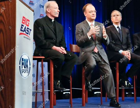 Providence President Rev. Brian Shanley, left, Georgetown President John DeGioia, center, and FOX Sports President and COO Randy Freer, right, appear during a news conference on in New York. Big East Conference schools gathered in New York to announce developments helping to shape the new NCAA college basketball focused conference