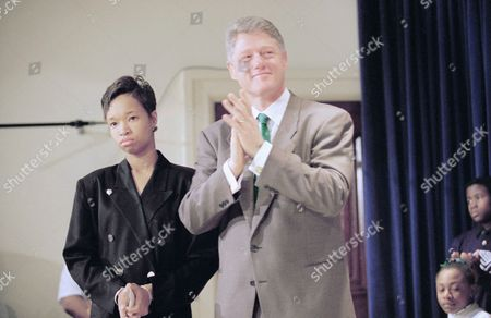 President Bill Clinton with Alicia Brown, a 14-year-old eighth grader in the District of Columbia, attend a White House ceremony in Washington, . The president unveiled a series of public services announcements for radio and TV in which he urges Americans to do more to fight violent crimes. A friend of Brown's was shot and killed here during a Friday night outing