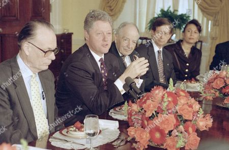 President Bill Clinton gestures while having brunch with leaders of senior citizens groups to discuss health care reform at the White House, Washington, . Arthur Fleming, president of Save Our Security, is at right. The red eye of the President is caused by conjunctivitis according to White House Press Secretary Dee Dee Myers