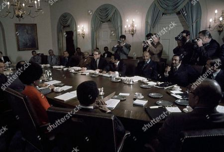 Stock Image of Richard Nixon Black Congressmen, all Democrats, meet with President Richard M. Nixon in the White House Cabinet Room in Washington on . Clockwise from lower right are Reps. Parren J. Mitchell, Maryland; Shirley Chisholm, New York; Charles C. Diggs Jr., Michigan; Nixon; Augustus F. Hawkins, California; William Clay, Missouri; Ronald V. Dellums, California; Nixon adviser Robert Finch; Hud Secretary George Romney; Walter Fauntroy, new D.C. delegate; Ralph H. Metcalfe and George H. Collins, Illinois; Robert N.C. Nix, Pennsylvania; Nixon adviser Clark MacGregor; John Conyers, Michigan; Louis Stokes, Ohiom and Charles B. Rangel, New York