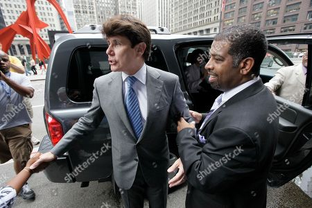 Rod Blagojevich Jason Wallace Law clerk Jason Wallace tries to coax Former Illinois Gov. Rod Blagojevich, away from supporters while leaving Federal Court, as the jury begins deliberations in his corruption trial, in Chicago. Rod Blagojevich's fate was in the hands of jurors Wednesday as they prepared to begin deciding whether the impeached Illinois governor tried to sell a nomination to President Barack Obama's former Senate seat and schemed to use his political power for personal gain