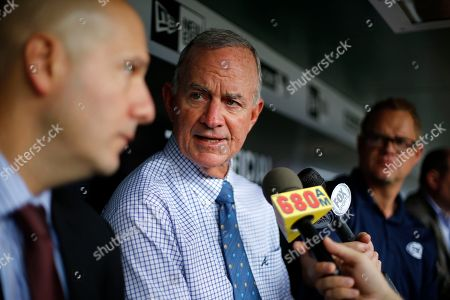 John Hart, John Coppolella Atlanta Braves President of Baseball Operations John Hart, center, and general manager John Coppolella, left, meet with reporters in the dugout before a baseball game against the Pittsburgh Pirates in Pittsburgh