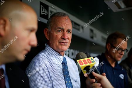 Stock Photo of John Hart, John Coppolella Atlanta Braves President of Baseball Operations John Hart, center, and general manager John Coppolella, left, meet with reporters in the dugout before a baseball game against the Pittsburgh Pirates in Pittsburgh