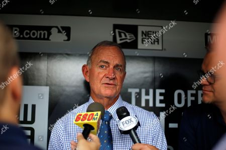John Hart Atlanta Braves President of Baseball Operations John Hart, center, talks with reporters in the dugout before a baseball game against the Pittsburgh Pirates in Pittsburgh