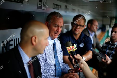 Stock Image of John Hart, John Coppolella Atlanta Braves President of Baseball Operations John Hart, center, and general manager John Coppolella, left, meet with reporters in the dugout before a baseball game against the Pittsburgh Pirates in Pittsburgh