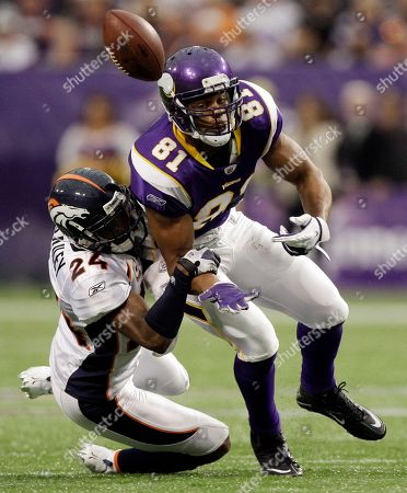 Denver Broncos' Champ Bailey (24) breaks up a pass intended for Minnesota Vikings' Visanthe Shiancoe (81) during the first half of an NFL football game, in Minneapolis
