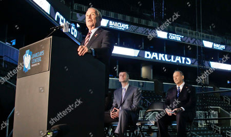 New York Mayor Michael Bloomberg speaks during a a ribbon cutting ceremony at Brooklyn's Barclays Center, as Brooklyn Nets owner Mikhail Prokhorov, center, and Forest City Ratner Companies Chairman and CEO Bruce Ratner, right, look on. After decades without a professional sports team, New York City's ascendant borough hit the major leagues again on Friday with the opening of the Brooklyn Nets' new arena