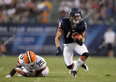 Stock Image of Dane Sanzenbacher, DeAngelo Smith Chicago Bears wide receiver Dane Sanzenbacher (18) eludes a tackle by Cleveland Browns defensive back DeAngelo Smith (25) in the first half an NFL preseason football game in Chicago