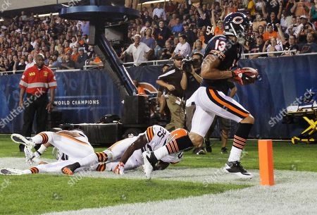 Stock Picture of Johnny Knox, DeAngelo Smith Chicago Bears wide receiver Johnny Knox (13) scores on a pass reception past Cleveland Browns defensive back DeAngelo Smith (25) and another Browns defender in the first half an NFL preseason football game in Chicago