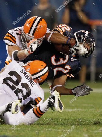 Kahlil Bell, Buster Skrine, Eric Gordon Chicago Bears running back Kahlil Bell (32) gets tackled by Cleveland Browns defensive back Buster Skrine (22) and linebacker Eric Gordon (57) in the first half an NFL preseason football game in Chicago