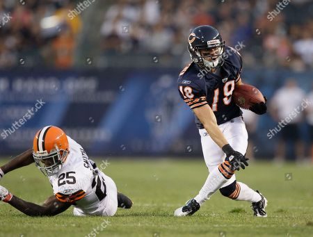Stock Photo of Dane Sanzenbacher, DeAngelo Smith Chicago Bears wide receiver Dane Sanzenbacher (18) eludes a tackle by Cleveland Browns defensive back DeAngelo Smith (25) in the first half an NFL preseason football game in Chicago